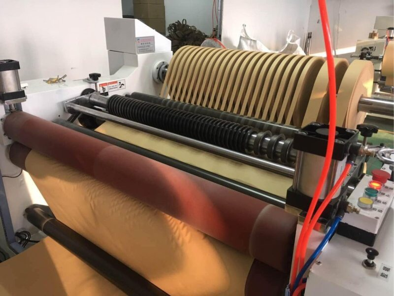 SLITTER REWINDER FOR TIPPING AND CIGARETTE PAPER